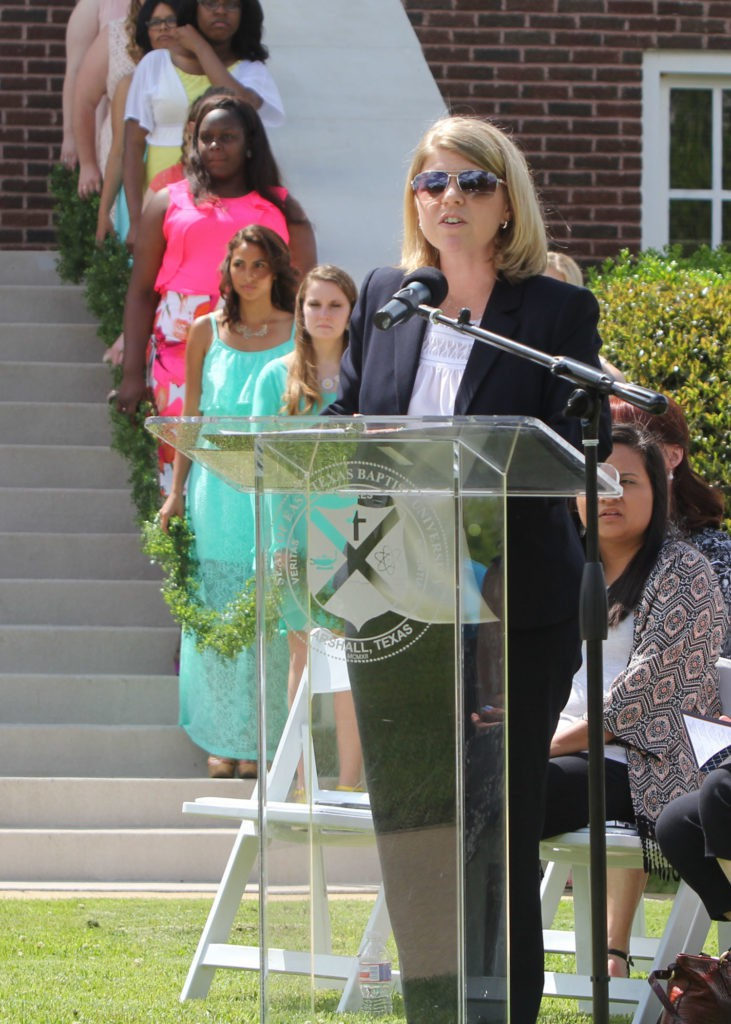 "East Texas Baptist University Vice President for Student Affairs Dr. Heather Hadlock welcomes everyone to the 69th Senior Girl-Call Out ceremony held on the front lawn of Marshall Hall. This year, 23 senior girls participated in the ceremony along with their ""little sisters"" who are underclassmen chosen by the seniors. From all the senior girls who choose to participate in the Call-Out, the ETBU faculty and staff elect one to honor as the Call-Out recipient.  PHOTO: ETBU/Mike Midkiff."