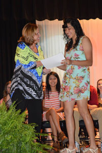 Cristal Monzon-Hernandez, MHS Class of 2016 Valedictorian, receives the Class of 1952/Poncho Patterson Scholarship Award from Helen Warwick, MISD Board of Trustees President, during last week's Senior Awards ceremony held at Marshall High School.