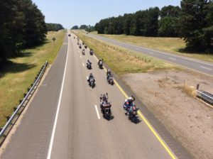 It was a moving moment as the riders were spotted on I-20, and they responded to the flags being waved in their honor. (Becky Holland/PWN Photos)