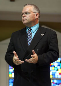 East Texas Baptist University Director of Public Relations Mike Midkiff speaking in a Chapel service in 2011. PHOTO: ETBU/Jason Cowart