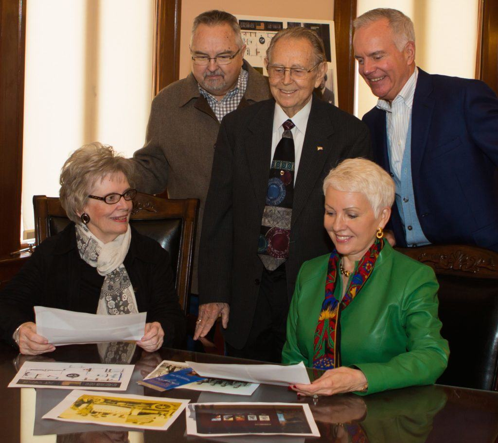 Seated:  Martha Robb, Harrison County Historical Museum, and Penny Carlile.  Standing, left to right, Robert Bailey, HCHM president, Harold Raines, HCHM board member, and Steve Carlile.